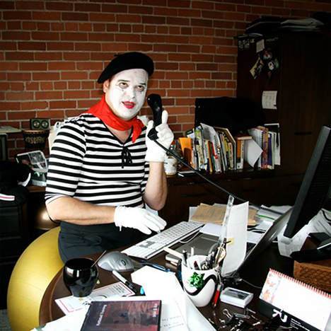 Photo of Tony answering a call in a pantomime costume